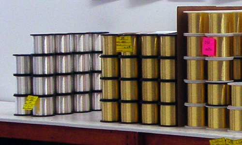 Rolls of guitar wire at United Wire Technologies